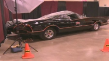 The legendary Batmobile is on display and visitors to the convention can climb inside for a picture.
