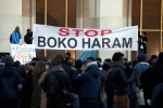 Men hold a banner during a gathering at the Trocadero place, in Paris, Sunday, Jan. 18, 2015 to protest against extremist Islamic group Boko Haram after a large-scale attack in Baga, where as many as 2,000 people were massacred in a raid on January 7, 2015. About 30 hostages abducted in Cameroon over the weekend by members of the Nigerian militant group Boko Haram have been released, Cameroon's military said Monday. (AP Photo/Thibault Camus)