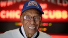 Chicago Cubs Hall of Fame slugger Ernie Banks smiles after an interview at the Cubs offices in Chicago on March 24, 2014. (AP / M. Spencer Green, File)