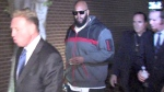 "This image from video shows Death Row Records founder Marion ""Suge"" Knight, right, walking into the Los Angeles County Sheriffs department early Friday morning Jan. 30, 2015. (AP / OnSceneVideo via AP Television)"