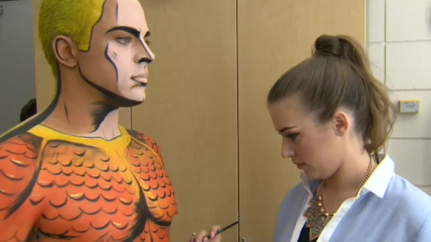 Moseley paints Aquaman onto a live model.