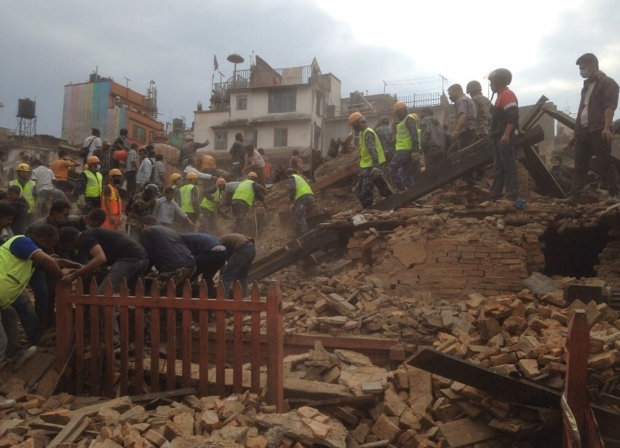 Rescuers clear the debris at Durbar Sqaure. A strong magnitude-7.9 earthquake shook Nepal's capital and the densely populated Kathmandu Valley before noon on Saturday, April 25, 2015. (AP / Niranjan Shrestha)
