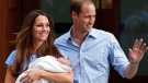 Prince William and Kate, Duchess of Cambridge hold the Prince of Cambridge, on July 23, 2013. (AP / Lefteris Pitarakis)