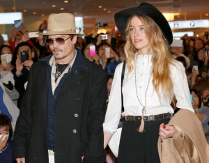 In this Jan. 26, 2015 file photo, U.S. actor Johnny Depp and Amber Heard arrive at Haneda international airport in Tokyo. (AP Photo/Shizuo Kambayashi, File)