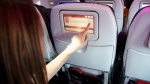 This product image provided by Virgin America Airlines shows a demonstration of the airline's in-flight on demand food and drink ordering system. (Virgin America via AP)