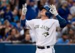 Toronto Blue Jays third baseman Josh Donaldson reacts after hitting a solo home-run against the Chicago White Sox during second inning AL baseball action in Toronto on May 25, 2015. (Nathan Denette / The Canadian Press)