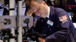 Trader Gordon Charlop works on the floor of the New York Stock Exchange, Monday, June 29, 2015. (AP / Richard Drew)