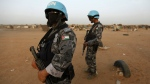 UNAMID (African Union/UN Hybrid operation in Darfur) peacekeepers patrol the area surrounding a polling station at Abou Shouk refugee camp, on the outskirts of the north Darfur capital of el Fasher, Sudan on April 7, 2010. (AP / Nasser Nasser)