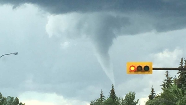 A funnel cloud forms in the skies over Calgary on Wednesday, July 22, 2015. (Angela Hales / MyNews)