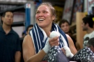 This July 15, 2015, file photo shows mixed martial arts fighter Ronda Rousey smiling during her workout at Glendale Fighting Club, in Glendale, Calif. (AP/Jae C. Hong, File)