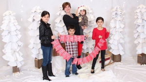 Mom Alison Azer, holds Meitan as her other children Sharvahn, left to right, Dersim and Rojevahn pose in this family handout image. (THE CANADIAN PRESS)