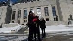 Lee Carter and her husband Hollis Johnson hug outside the Supreme Court of Canada, after it struck down a ban on providing a doctor-assisted death, in Ottawa, on Friday, Feb. 6, 2015. (THE CANADIAN PRESS/Sean Kilpatrick)