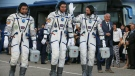 Kazakhstan's cosmonaut Aydyn Aimbetov, left, Russian cosmonaut Sergei Volkov, centre, and Denmark's astronaut Andreas Mogensen, members of the main crew of the expedition to the International Space Station (ISS), walk prior the launch of Soyuz-FG rocket at the Russian leased Baikonur cosmodrome, Kazakhstan on Sept. 2, 2015. (AP / Dmitry Lovetsky)
