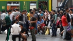 Migrants wait at the Keleti Railway Station in Budapest, Hungary, Thursday, Sept. 3, 2015. (Zsolt Szigetvary/MTI via AP)