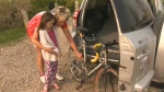 Lynn Fast explains the workings of her bicycle to her granddaughter Talon