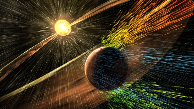 An artist's rendering of a solar storm hitting Mars and stripping ions from the planet's upper atmosphere. (NASA / GSFC)