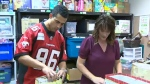 Calgary Stampeder Anthony Parker help pack toys for CTV Calgary's Toy Mountain campaign.