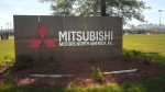 A sign outside the Mitsubishi Motors North America plant in Normal, Ill. is pictured on July 24, 2015. (David Proeber / The Pantagraph)