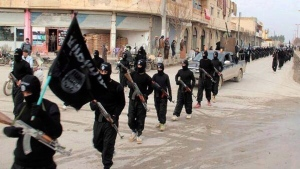This undated file image posted on a militant website on Jan. 14, 2014, which has been verified and is consistent with other AP reporting, shows fighters from the Islamic State marching in Raqqa, Syria. (Militant Website/AP/The Canadian Press)