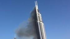 Dubai tower smoldering