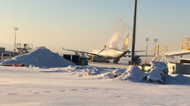 The Lufthansa aircraft undergoes deicing in preparation of departing Calgary for Los Angeles