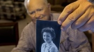 Norwood Thomas, 93, holds up a photo of with Joyce Morris at his home in Virginia Beach, Va. on Nov. 6, 2015. (Bill Tiernan / The Virginian-Pilot)