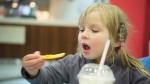 A child eating. (Aleph Studio / shutterstock.com)