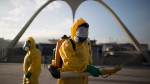 A health worker stands in the Sambadrome as he sprays insecticide to combat the Aedes aegypti mosquitoes that transmits the Zika virus in Rio de Janeiro, Brazil, Tuesday, Jan. 26, 2016. (AP / Leo Correa)
