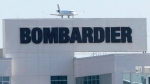 A plane comes in for a landing at a Bombardier plant in Montreal, Thursday, May 14, 2015. (Ryan Remiorz / The Canadian Press)