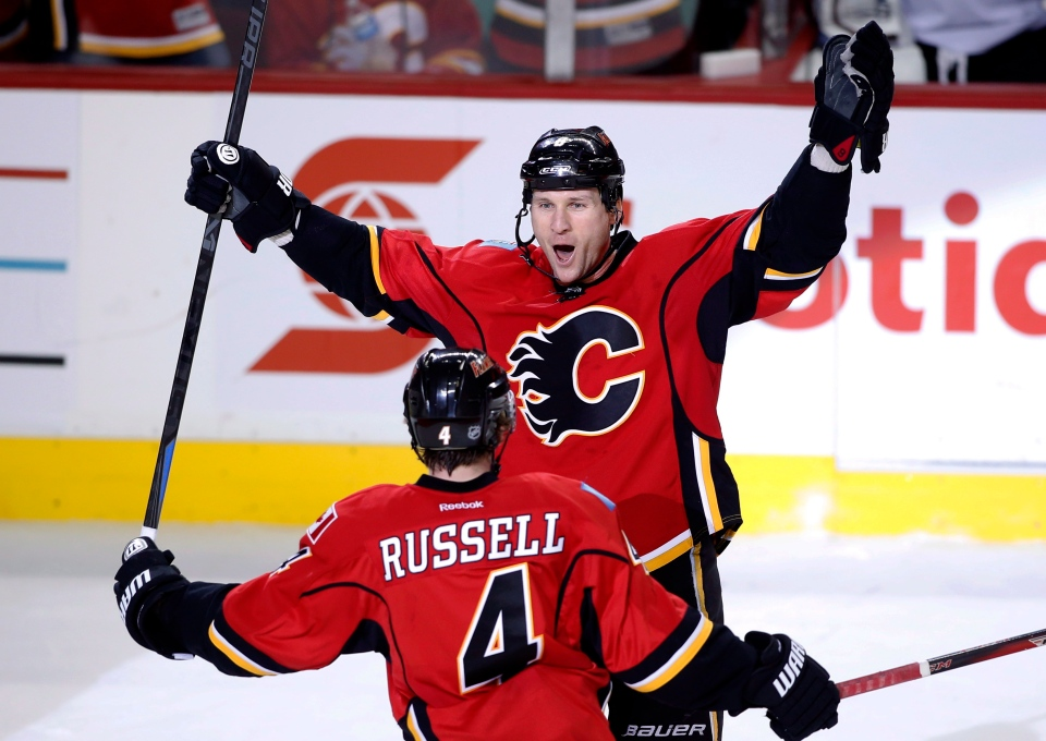In this file photo, Calgary Flames' Dennis Wideman celebrates scoring a goal in Calgary, Alta., Thursday Dec. 4, 2014. (Larry MacDougal / THE CANADIAN PRESS)