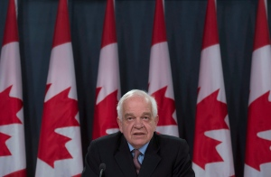 Immigration Minister John McCallum updates the media on the Syrian refugees arriving in Canada, during a news conference in Ottawa, Wednesday, Feb. 3, 2016. (Adrian Wyld / THE CANADIAN PRESS)