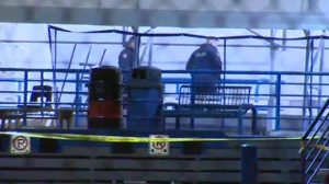 CPS members survey the sliding track at Canada Olympic Park following an after hours crash that claimed two teenagers