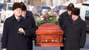 Pallbearers carry the casket for the funeral service of Suzanne Bernier Saturday, February 6, 2016 in Quebec City. (Jacques Boissinot / THE CANADIAN PRESS)