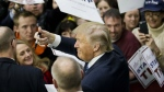 Republican presidential candidate Donald Trump gestures to the crowd as he signs autographs at a campaign event at Plymouth State University in Plymouth, N.H. on Sunday, Feb. 7, 2016. (AP / David Goldman)