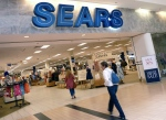 In this May 14, 2012 file photo, shoppers walk into Sears in Peabody, Mass. (AP/Elise Amendola)