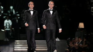 Canadian designers Dean and Dan Caten take the catwalk at the end of their DSquared2 men's Fall-Winter 2013-14 collection, part of the Milan Fashion Week, unveiled in Milan, Italy, Tuesday, Jan. 15, 2013. (THE CANADIAN PRESS/ AP/Antonio Calanni)