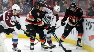 Ottawa Senators' Chris Neil (25) fights for the puck against Colorado Avalanche's John Mitchell (7) during second period NHL hockey action in Ottawa on Thursday, Feb. 11, 2016. (THE CANADIAN PRESS / Sean Kilpatrick)