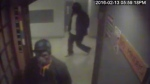 Surveillance video shows the robbery in progress.