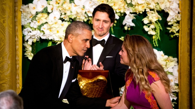 President Barack Obama greets Sophie Grégoire Trudeau after toasting to Canadian Prime Minister Justin Trudeau, center, during a State Dinner in the East Room of the White House in Washington, Thursday, March 10, 2016. (Jacquelyn Martin / AP)