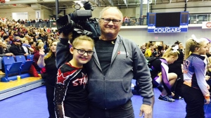 Natasha posed for a photo with Kevin after her debut with the Calgary Stars Gymnastics and Cheerleading Club.