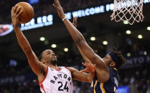 Toronto Raptors guard Norman Powell (24) goes to the basket against Indiana Pacers forward Myles Turner (33) during the first half of NBA Basketball action in Toronto on Friday, April 8, 2016. (The Canadian Press/Peter Power)