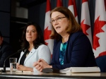 Health Minister Jane Philpott, right, speaks as Justice Minister Jody Wilson-Raybould looks on at a news conference in Ottawa on Thursday, April 14, 2016. (Adrian Wyld / THE CANADIAN PRESS)