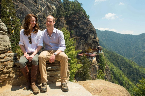 The Duke and Duchess of Cambridge pose for photo during their hike to the Tiger's Nest Monastery, near Paro, Bhutan, Friday April 15, 2016. (Joe Giddens / PA)