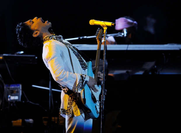 Prince performs during his headlining set on the second day of the Coachella Valley Music and Arts Festival in Indio, Calif., Saturday, April 26, 2008. (AP Photo/Chris Pizzello)