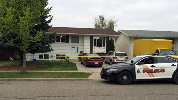 An LPS unit and crime scene tape outside of the home on 18 Street North following a fatal assault