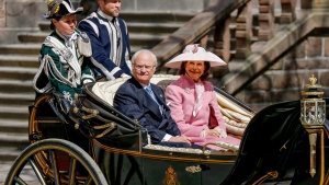 Sweden's Queen Silvia and King Carl XVI Gustaf arrive in an open carriage for lunch hosted by the City of Stockholm at the City Hall, part of the celebrations for the king's birthday, in Stockholm, Sweden, Saturday, April 30, 2016. (Christine Olsson / TT News Agency via AP)