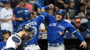 Toronto Blue Jays' Jose Bautista (19) is congratulated by Josh Donaldson, right, after Donaldson scored off Bautista's two-run home run, as Tampa Bay Rays catcher Curt Casali stands at home plate, during the third inning of a baseball game in St. Petersburg, Fla., Saturday, April 30, 2016. (AP Photo / Phelan M. Ebenhack)