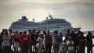 People watch Carnival's Adonia cruise ship arrive from Miami, in Havana, Cuba, Monday, May 2, 2016. The Adonia's arrival is the first step toward a future in which thousands of ships a year could cross the Florida Straits, long closed to most U.S.-Cuba traffic due to tensions that once brought the world to the brink of nuclear war. (Ramon Espinosa / AP)