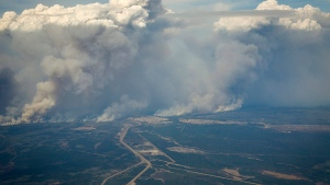 Wildfires burn in and around Fort McMurray, Alberta, Wednesday, May 4, 2016. The raging wildfire emptied Canada's main oil sands city, destroying entire neighborhoods of Fort McMurray, where officials warned Wednesday that all efforts to suppress the fire have failed. (Jeff McIntosh / The Canadian Press)