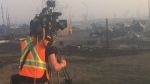 Recording the devastation in Fort McMurray, Alberta. (CP)